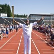 Marlon Devonish carries the torch at Crystal Palace stadium