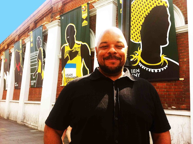PROUD: Jon Daniels with the Jamaica 50 images he designed on Coldharbour Lane, Brixton