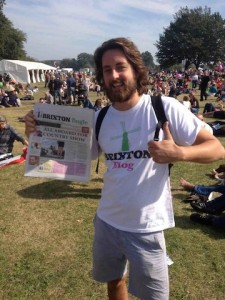 Brixton Bugle volunteer Al Hadden gives out copies of the paper