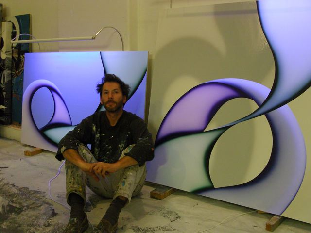 Rufus Knight-Webb in his studio with some of his recent paintings.