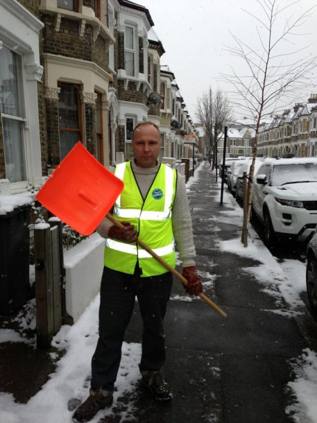 Snow warden James Cornish gets serious with his shovel in Leander Road