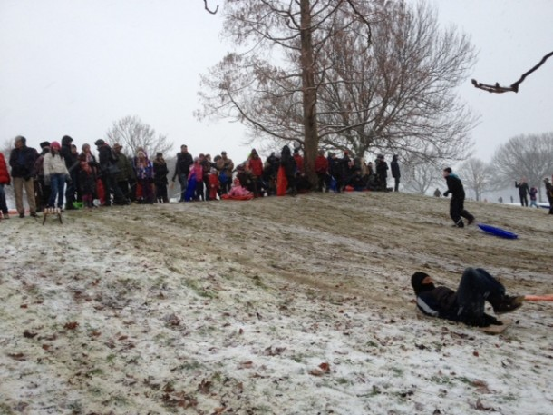 Hundreds lined the top of the main Brockwell Park piste, taking turns to descend on sleds, horses and estate agents' boards! Pic Tim Dickens