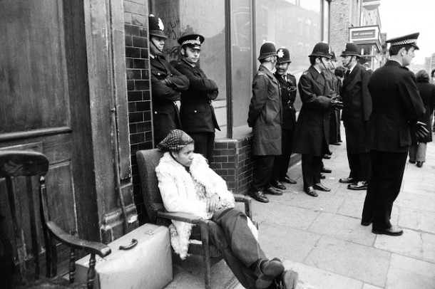 Liz Obi sits outside an eviction in 1974. Chris Steele-Perkins