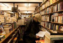 man browsing bookstore