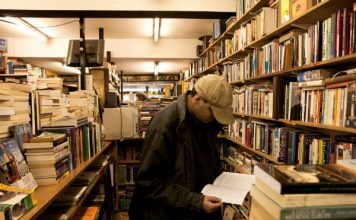 man browsing bookstore