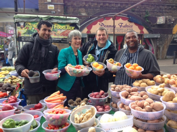 From left to right: Karim Sherzad, fruit and vegetable trader; Cllr Jackie Meldrums; Stuart Horwood, CEO of Brixton Market Traders' Federation and Jeff, Caribbean food trader