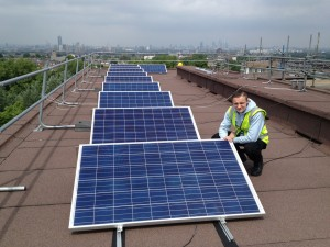 Blazej Mokowski, 16, helps install the solar panels with Brixton Energy on Roupell Park Estate