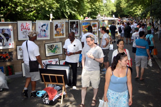 Visitors browse the wide collection on show at the Urban Art Fair in leafy Josephine Avenue