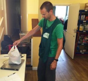 Volunteer weighing food at the Brixton Food Bank