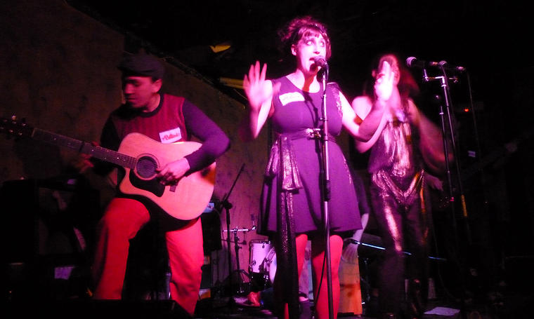 Catherine Martindale performing with Poeticat at the Windmill