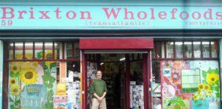 man in shop doorway