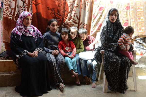 Amal Awad Odeh (left) Hanan Ahmed Jadaan (right) and their children in Mafraq - Hanan has been served with an eviction notice to leave her home