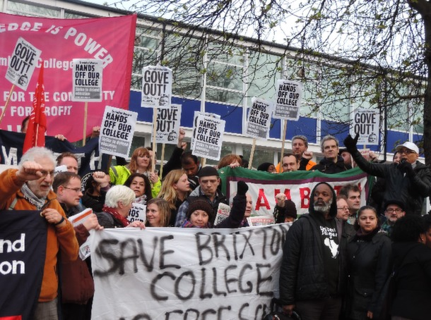 ANGRY: Protestors join hands at the front of the Lambeth College Brixton centre. Pic by Katie Lathan
