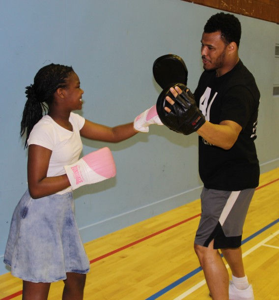Budding boxer spars with AJ Carter