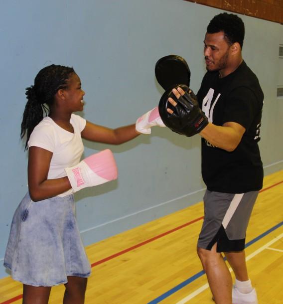 Budding boxer spars with AJ Carter