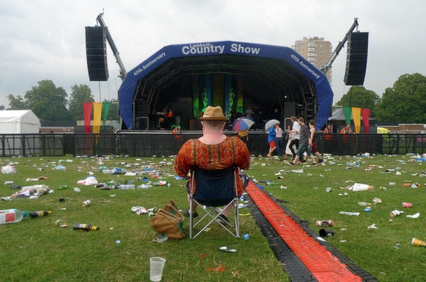 DON'T TURN AROUND: One Aswad fan stays put in front of the main stage as thunderstorms gave the Lambeth Country Show-goers an early bath. Picture by @Cononino on Flickr.