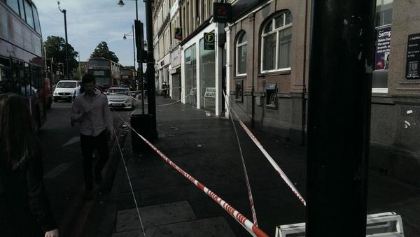 A police cordon outside Foxtons on Brixton Road yesterday. Pic by @Thomas_Page on Twitter