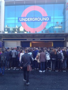 People queue to enter Brixton Tube last month. Picture by @iamnads