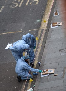 Forensic officers comb the crime scene in Coldharbour Lane. Picture by @beej222 on Twitter