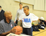 Bruce Bowen with a young basketball player