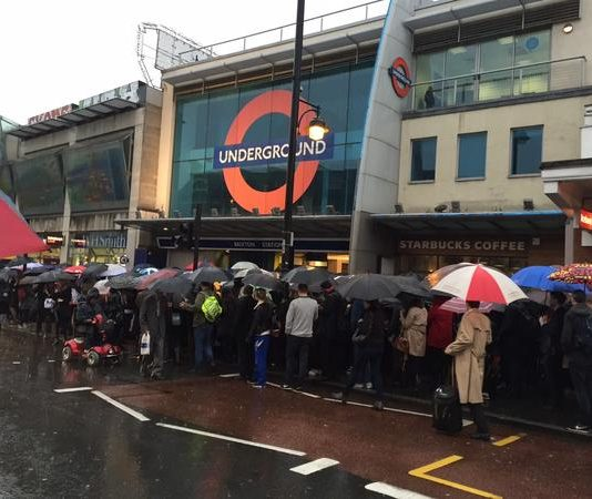 Commuters queuing at Brixton Tube in 2014 when two escalators were out of action