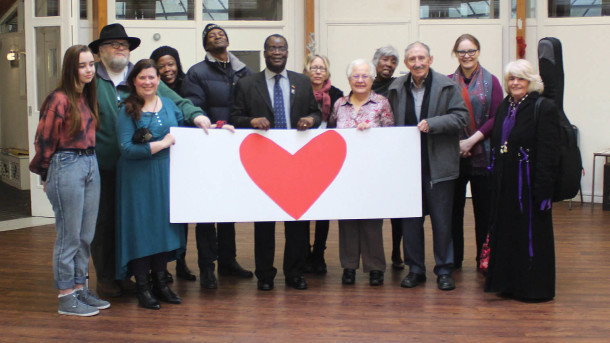 Cressingham residents and supporters present Mayor of Lambeth Adedamola Aminu with their giant Valentine
