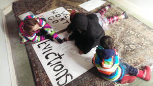 Children from the estate make posters protesting against their eviction