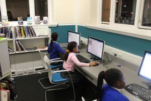 Children working at Brixton library