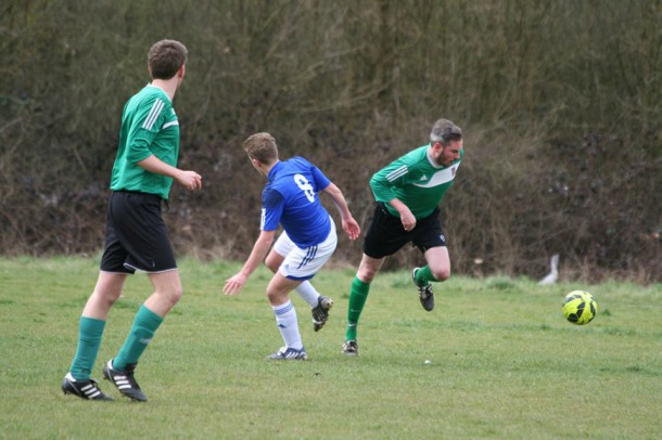 Ben Swindells (Pictured on the far right) running past a Wimbledon Town player (Photo: Clare Barnett).