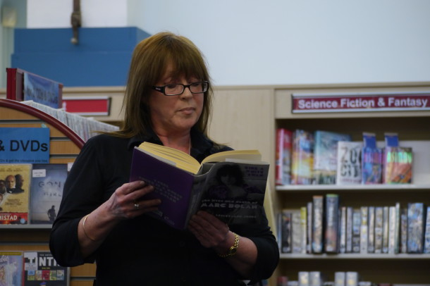 Local author Leslie-Ann Jones reads from her book on Marc Nolan at Minet Library support meeting