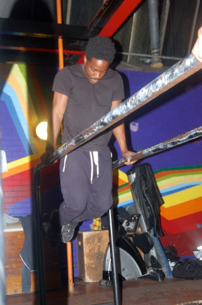 Block Workout member using the parallel bars at Brixton's Street Gym (Sandra Brobbey for Brixton Blog)