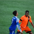 A Lambeth Tiger player (pictured in orange) in action in the Under-14 London FA Youth Cup.