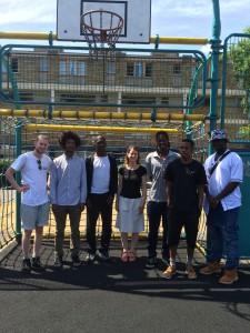 Helen Hayes MP with Joel with members of Football Beyond Borders Youth Leadership Team