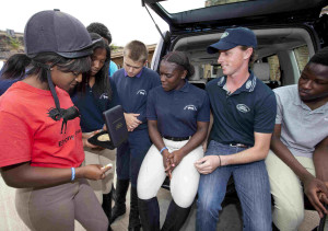 Olympic medallist Ben Maher with Ebony Horse Club riders. Credit: on Edition