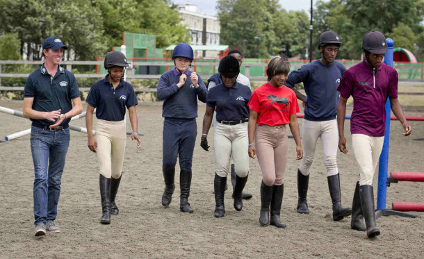 Ben Maher, far left, with Ebony Horse Club members. Credit: onEdition