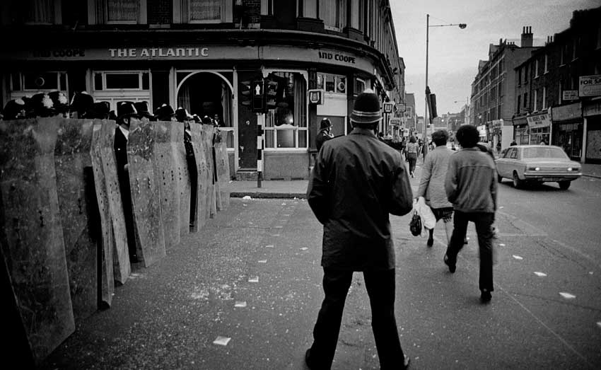 """April 1981: Police form a barricade across Railton Road outside the Atlantic, now the Dogstar. PICTURE: """"1981 Brixton Riots"""" by Kim Aldis. Licensed under CC."""