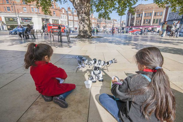 Children play with robots in Windrush Square