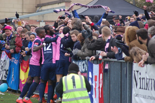 Dulwich Hamlet players celebrating a goal with fans at Champion Hill (Photo: Brixton Blog)