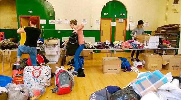 Volunteers sort donations