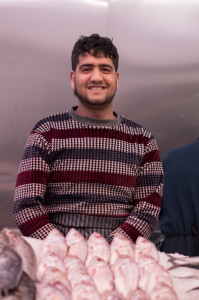 Mr Malik stands by some fresh fish