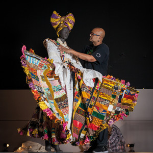 Brixton-based designer Ray Mahabir with his costume commisioned by the British Library. Photograph by Toby Keane