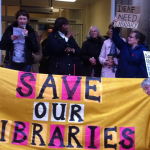 Alison Higgs speaking in front of Tate Brixton Library