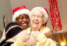 Elderly people in christmas hats