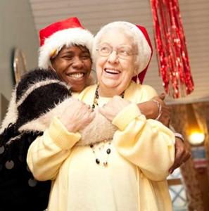 Elderly people in christmas hats