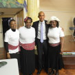 "MP Chuka Umunna with three women performers from the play ""Linstead Market"