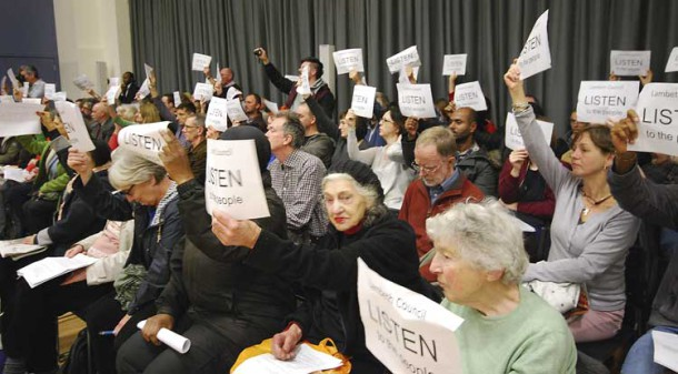 Protesters held up signs urging councillors to listen to their protest
