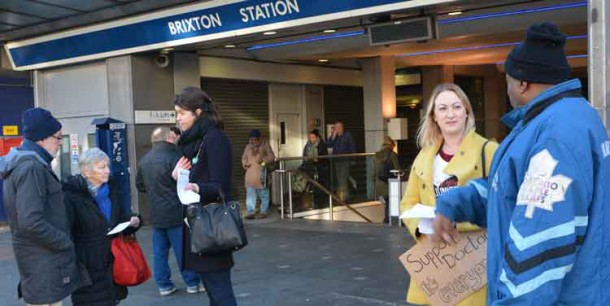 Mary Thornton and Leah Jones discuss the strike with passers-by outside Brixton Tube station