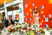 Bowie mural with floral tributes
