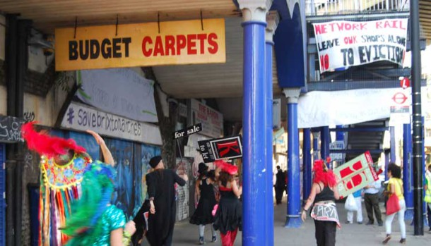 Anti-gentrification protesters outside Budget Carpets