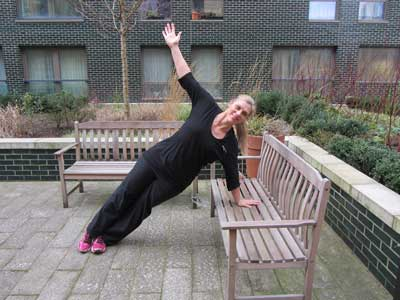 Side plank exercise on a bench